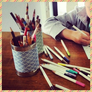 Pencil holders: cans covered with origami paper