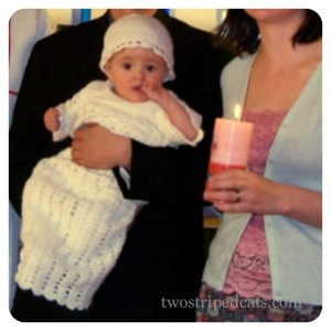 Miss L donning Mum's crochet christening gown